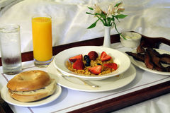 Breakfast Room Service. This is an image of a breakfast tray on a bed royalty free stock image