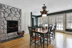 Breakfast room with stone fireplace Royalty Free Stock Images