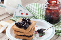 Breakfast With Rusks And Sour Cherries Jam Stock Photography