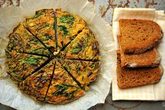 Breakfast with rustic frittata and bread on a wooden board Stock Photography