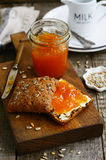 Breakfast with rye bread, apricot jam, sunflower seeds and milk Royalty Free Stock Image