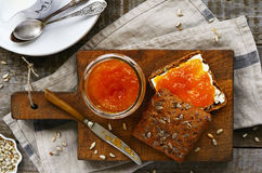 Breakfast with rye bread, apricot jam, sunflower seeds and milk Royalty Free Stock Photo