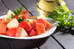 Breakfast. Salad tomato and apples. Vegan diet. Royalty Free Stock Photography