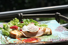 Breakfast with salads. Fried egg for breakfast with salads and ham Royalty Free Stock Photography