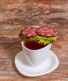 Breakfast with salami sandwich and cup of tea Royalty Free Stock Images