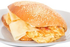 Breakfast Sandwich with Bacon and Fried Scrambled Egg. Stock Photo