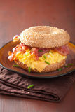 Breakfast sandwich on bagel with egg bacon cheese Royalty Free Stock Images