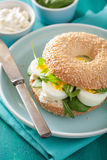 Breakfast sandwich on bagel with egg cream cheese arugula Stock Photo