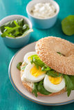 Breakfast sandwich on bagel with egg cream cheese arugula Royalty Free Stock Image