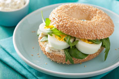 Breakfast sandwich on bagel with egg cream cheese arugula Royalty Free Stock Photo