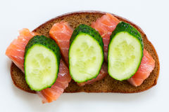 Breakfast sandwich: black bread, smoked salmon, and fresh cucumbers Stock Photo