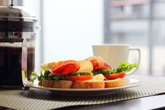 Breakfast with sandwich and coffee. Healthy breakfast with sandwiches and coffee in french press, scandinavian style royalty free stock photography