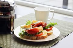 Breakfast with sandwich and coffee. Healthy breakfast with sandwiches and coffee in french press, scandinavian style stock photography