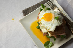 Breakfast sandwich, croque madame with fried egg with ham and me Royalty Free Stock Photo