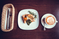 Breakfast sandwich with a cup of coffee Royalty Free Stock Images