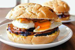Breakfast sandwich with eggs, ham, mushrooms and cheese Stock Image