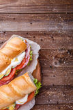 Breakfast with sandwich from sausage. Breakfast with sandwich from vegetables and sausage on wooden table Stock Photo