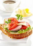 Breakfast sandwich with sliced sausage and tomato Royalty Free Stock Photo