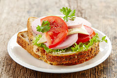 Breakfast sandwich with sliced sausage and tomato Stock Photography