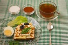 Breakfast sandwich and tea_1. Breakfast - sandwich, egg and tea Stock Photo