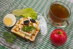 Breakfast sandwich and tea_3. Breakfast - sandwich, egg and tea Stock Photo
