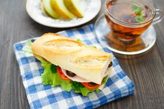 Breakfast with sandwich, tea and melon Stock Images
