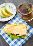 Breakfast with sandwich, tea and melon Royalty Free Stock Photos