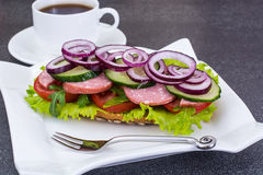 Breakfast sandwich with vegetables and ham, tea, coffee Stock Photography