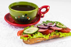 Breakfast sandwich with vegetables and ham, tea, coffee Stock Photos
