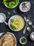 Breakfast sandwiches with egg's scramble, radish and green peas. Delicious healthy food Royalty Free Stock Photos