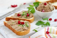 Breakfast sandwiches with homemade chicken liver pate. Delicious sandwiches with homemade chicken liver pate served with greens and berries stock photos