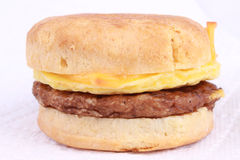 Breakfast sausage biscuit. With egg, sausage and cheese sandwich in bread bun; isolated on white background Royalty Free Stock Photo