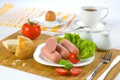 Breakfast sausages, tomato, egg Stock Photo