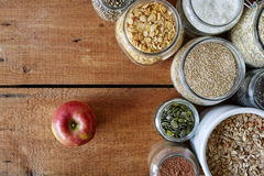 Breakfast scene apple and variety of cereals. 