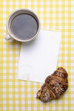 Breakfast scene with Coffee, Croissant, Jam and Blank Paper Stock Images