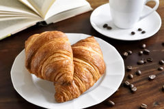 Breakfast scene with fresh croissants Stock Image
