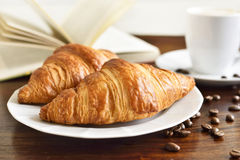 Breakfast scene with fresh croissants Stock Images
