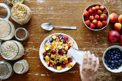 Breakfast scene hand pouring milk on muesli healthy lifestyle organic nutrition. 