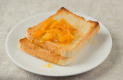 Breakfast scene. Orange jelly on the toasts Stock Photos