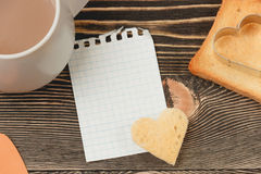 Breakfast scene with toast, cup on wooden table. Top view Royalty Free Stock Photography