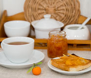 Breakfast scene. Toast with home-made orange marmalade, served with a cup of tea Stock Images