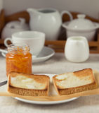 Breakfast scene. Toast with home-made orange marmalade, served with a cup of tea Stock Photo