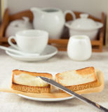 Breakfast scene. Breakfast: Toasts with butter and tea Stock Photo