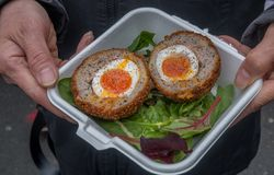 Breakfast of Scotch eggs and vegetable salad traditional pork & sage stock photo