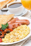Breakfast with scramble eggs, sausage, toast Stock Photography