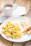 Breakfast, scrambled egg with toasts and coffee. Royalty Free Stock Photography