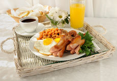 Breakfast with scrambled eggs and bacon. Breakfast with scrambled eggs, bacon, sausage and beans Stock Photography