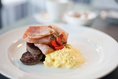 Bacon, sausage and eggs breakfast Royalty Free Stock Photo