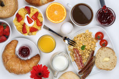 Breakfast with scrambled eggs, fruits, coffee and orange juice f. Breakfast with a cereals, bagels, scrambled eggs, marmalade, coffee and orange juice from above Stock Photography