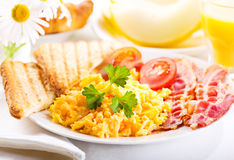 Breakfast with scrambled eggs, juice and fruits Royalty Free Stock Photo